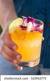 Hand Holding a Mai Tai Cocktail