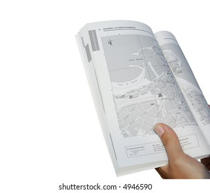 Hand holding a map - focus on map. Includes clipping path.