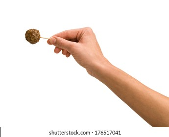 Hand Holding Meatball on Toothpick on White, hors doeuvres
