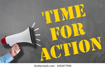 hand holding megaphone or bullhorn against blackboard with text TIME FOR ACTION, no procrastination concept