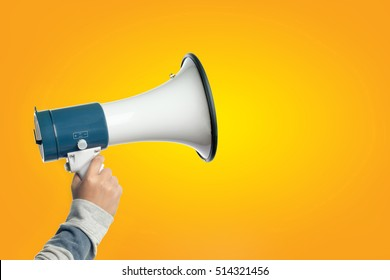 Hand holding Megaphone, Loudspeaker with copy space