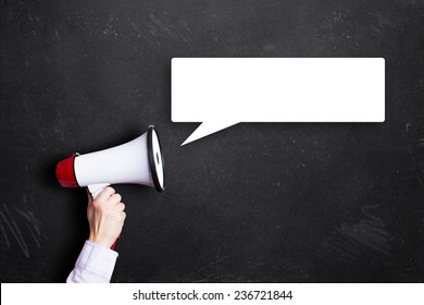 hand holding a megaphone with a speech bubble