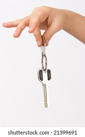 Hand holding metal key isolated over white background
