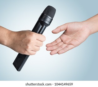 Hand holding microphone on blue background,Get  microphone