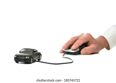 Hand holding miniature car computer mouse isolated on white background