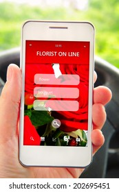 hand holding mobile phone with florist offer on screen. focus on screen