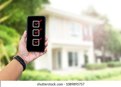 Hand holding mobile phone, Home inspection