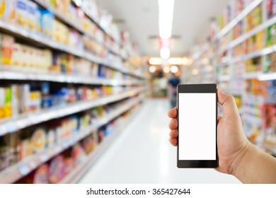 hand holding mobile phone on Supermarket blur background, business concept