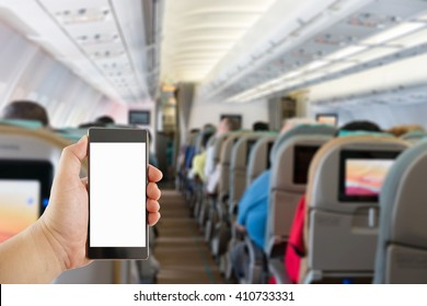 hand holding mobile phone on Airplane interior blur background