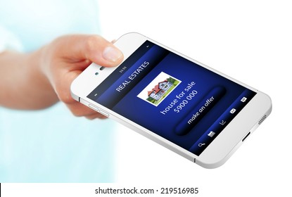 hand holding mobile phone with real estate offer isolated over white background