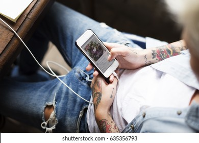 Hand Holding Mobile Phone Showing Sending Data Screen