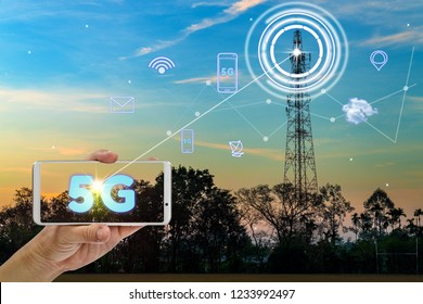 hand holding mobile smart phone using 5G network interface and icon