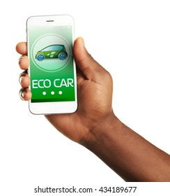 Hand holding mobile smart phone, isolated on white. Eco car concept