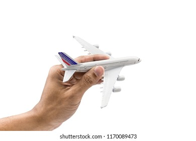 Hand holding a model plane isolated on white background.Transportation and traveling with airplane concept. Close up with Clipping Path.