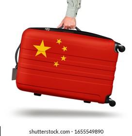 Hand holding modern suitcase China flag design isolated on white