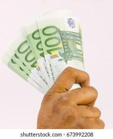 Hand holding money, Euro money.