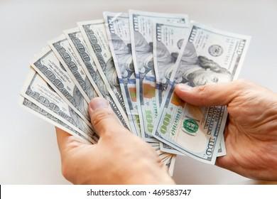 Hand holding money - United States dollar, close up