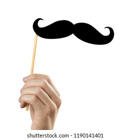 Hand holding moustache on a stick, isolated on white background