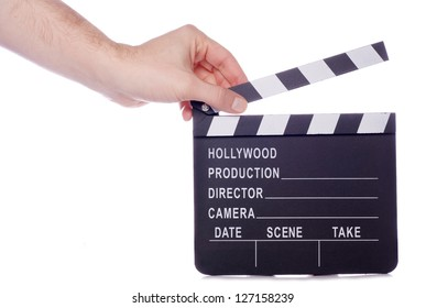 Hand holding movie clapper studio cutout