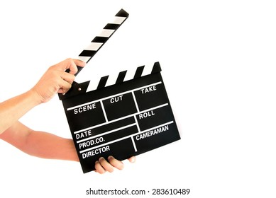 Hand holding a movie director scene card on white background.