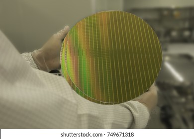 Hand holding moving a silicon wafers stacked pieces which causing damage the wrong way method, semiconductor.  blurred background