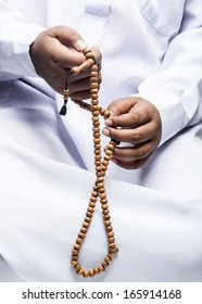 hand holding a muslim rosary