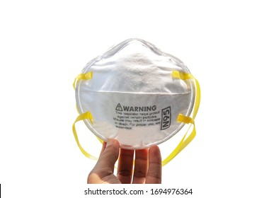 Hand holding N95 mask for protection against pollution, virus, flu and coronavirus (Covid-19). Protection pm 2.5. Air face mask. Medical Doctor mask on white background with clipping path. Copy space.