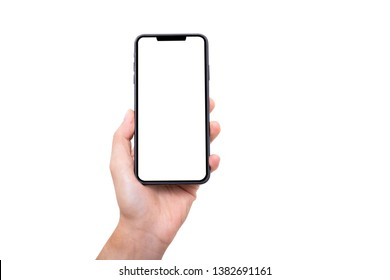 Hand holding new smartphone on white background - Shutterstock ID 1382691161