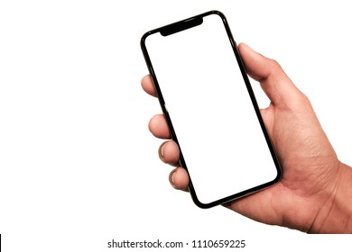 Hand holding, New version of black slim smartphone similar to iphone x with blank white screen from Apple generation 10 , Front mockup model similar to iPhonex , Background of digital economy.