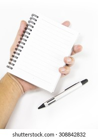 hand holding notebook on white background