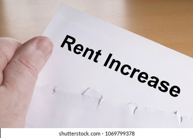 hand holding notice of rent increase letter
