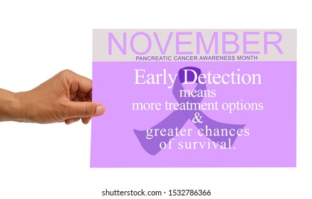 Hand holding November Pancreatic Cancer Awareness Month Sign (Early Detection means more treatment options & greater chances of survival.)