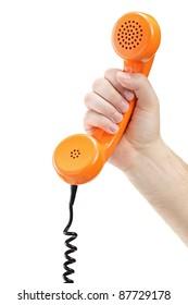 Hand holding an old orange telephone tube isolated on white background