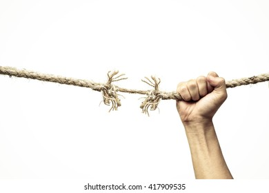Hand holding on almost torn apart rope - Risk concept