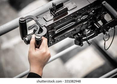 hand holding on machine gun ship