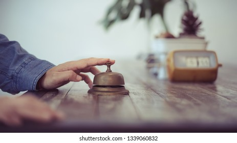 hand holding on old style bell with vintage decoration, service calling concept