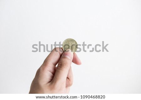 hand holding one pound coin white stock photo edit now 1090468820