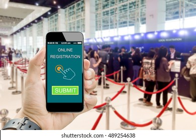 hand holding online registration on smartphone with blurred people registration as background