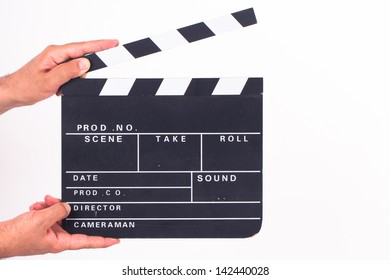 Hand holding and opening black cinema clapper board, isolated on white background.