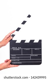 Hand holding and opening black film clapper board, isolated on white background.