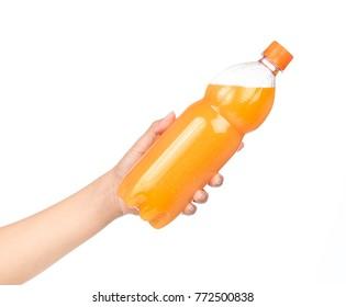 hand holding orange juice in bottle isolated on white background