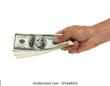 Hand holding out a stack of hundred dollar bills side view