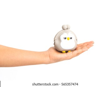 hand holding an owl toy isolated on white background