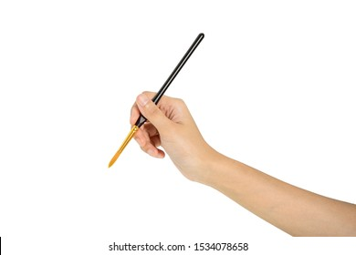 hand holding paint brush with white background and clipping path