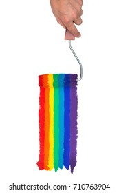 Hand Holding a paint Roller, painting Rainbow colors on an isolated White Background