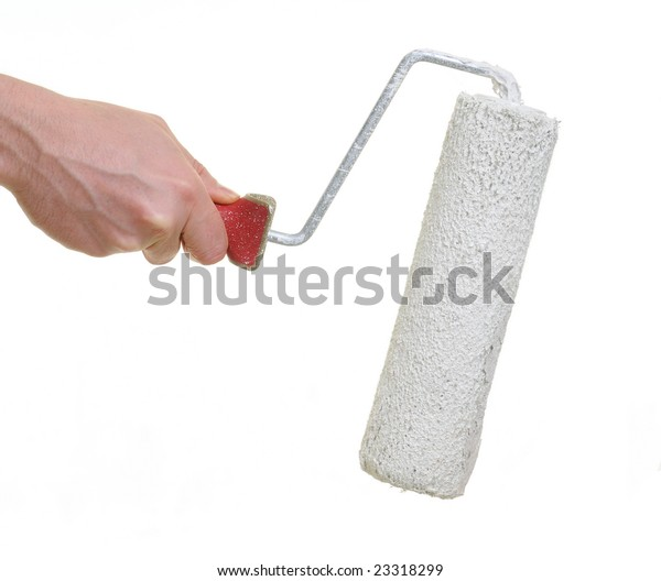 hand holding painting brush roller over white background