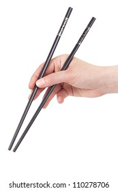 Hand holding a pair of chopsticks, isolated on white background.