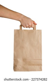 Hand holding a paper bag isolated on white background. Delivery concept
