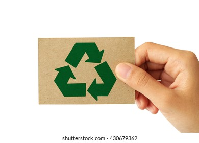 Hand holding a paper card with the recycling sign isolated on white background