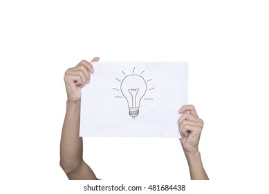 hand holding paper inspiration concept crumpled paper light bulb metaphor for good idea creative design